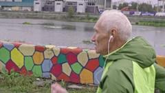 Senior Man Running along River Stock Footage