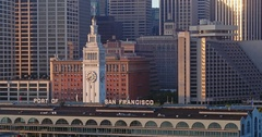 Aerial of San Francisco Ferry Building, Embarcadero & city at sunrise Stock Footage