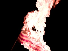 US Flag Burning in Protest Slow Motion 2K Stock Footage