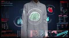 Female doctor touching brain, heart, lungs, internal organs in digital display Stock Footage