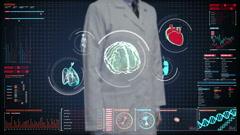 Doctor touching digital, brain, heart, lungs, internal organs in digital display Stock Footage
