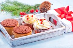 Muffins and christmas decoration on a table Stock Photos