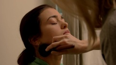Brush applying makeup on lady. Stock Footage