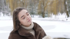 Pretty girl correcting and posing with hat in winter day Stock Footage