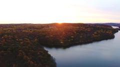 Aerial sunrise shot of Weschester and wilderness during the Autumn - 4k Stock Footage
