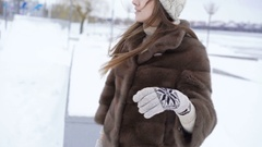 Beautiful young thinking girl looking aside in winter day. 4K Stock Footage
