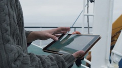 Dressed in Protective Coat Fisherman Using Tablet Computer with Navigation Maps  Stock Footage