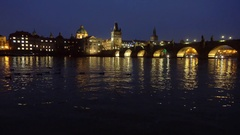 Famous landmark Charles bridge at dusk Stock Footage