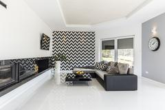 Bright living room with stylish couch Stock Photos