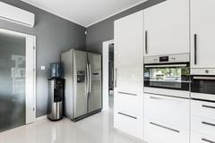 Stylish open plan kitchen with silver fridge Stock Photos