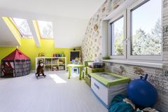 Bright room for children with roof windows Stock Photos