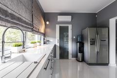 Modern kitchen with big windows Stock Photos