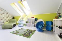 Green child room with roof windows Stock Photos