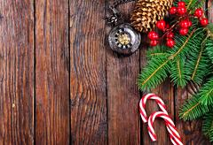 Christmas decoration and fir on the wooden table Stock Photos