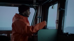 Captain Pilots Commercial Fishing Ship. Stock Footage
