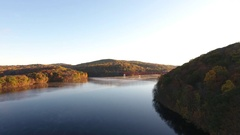 Aerial shot of an upstate New York reservoir at sunrise - 4k Stock Footage