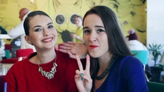 Two friends in front of a web camera in the cafe Stock Footage