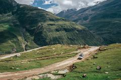 Off road expedition vehicle on the mountain road among Himalaya hills Stock Photos