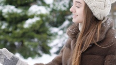 Young woman drinking tea at snowy tree. Slowly Stock Footage