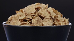 Granola cereal, nuts and raisins rotating . Crunchy tasty muesli food background Stock Footage