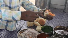 Person making Kutchi dabeli the Indian healthy fast food from left side Stock Footage