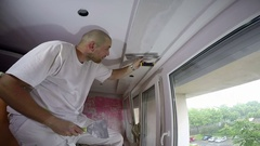 Worker Spreading Plaster To Ceiling With Trowel Stock Footage