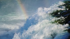 Incredible Niagara Falls and a rainbow over it. The flow of water falls down Stock Footage