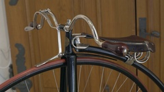 Penny-farthing high wheel vintage bicycle handle bar and seat Stock Footage