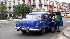 Сarpooling in Havana. Local girls agree to travel with a car driver. Stock Footage
