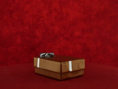 Gift present box on red background Stock Footage