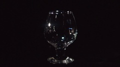 Whiskey Pouring into Glass on Black Stock Footage