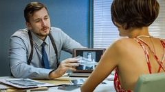 Detective shows criminals pictures, the girl in handcuffs testifying. Stock Footage