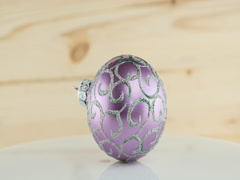 Violet ball on wooden background Stock Footage