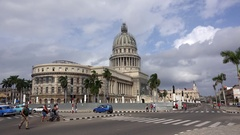 Road traffic with old American cars at the Paseo de Marti front of the Capitol Stock Footage
