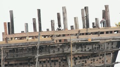 Ship worker making ship at shipyard top Stock Footage