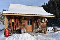 Cave exploration equipment hanged on a wooden cabin Stock Photos