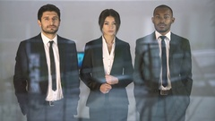 The three business people stand over the window. Real time capture Stock Footage