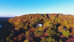 House in the mountains - autumn - aerial - 4k Stock Footage