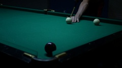Black ball rolls into the pocket Stock Footage