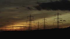 High-voltage transmission line in sunset Stock Footage