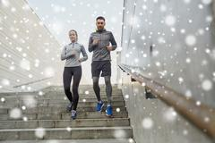 Couple of sportsmen running downstairs outdoors Stock Photos