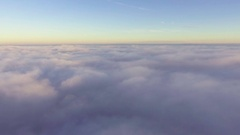 Flyig above clouds at morning Stock Footage