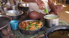 Indian food and sweets cooking, preparation, serving at a Dhaba Stock Footage