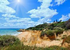 Atlantic sunshiny rocky coast view (Algarve, Portugal). Stock Photos