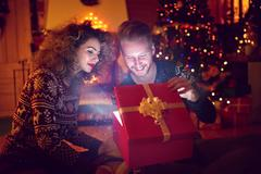 Christmas eve with magic gift in red box Stock Photos