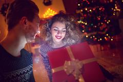 Magic surprise in box for young woman Stock Photos