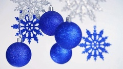 Beautiful Christmas and New Year blurry blue shining balls and snowflakes Stock Footage