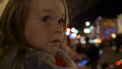 Little Girl Watches Christmas Parade, 4K Stock Footage