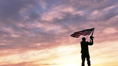 4K. Soldier silhouette with rifle waves American Flag against gloomy sky Stock Footage
