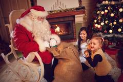Santa Claus take out gifts from the bag Stock Photos